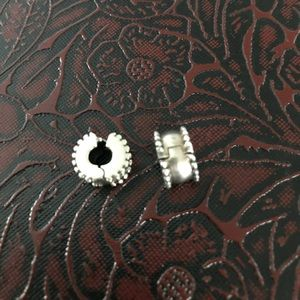 2 Pandora beveled clip charms used